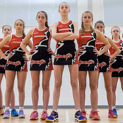 Kingston Wildcats team wearing Spall custom netball kits