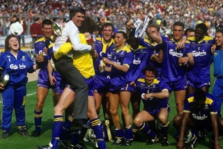 The new and underdog team Wimbledon AFC having just won the 1988 FA Cup in Spall shirts